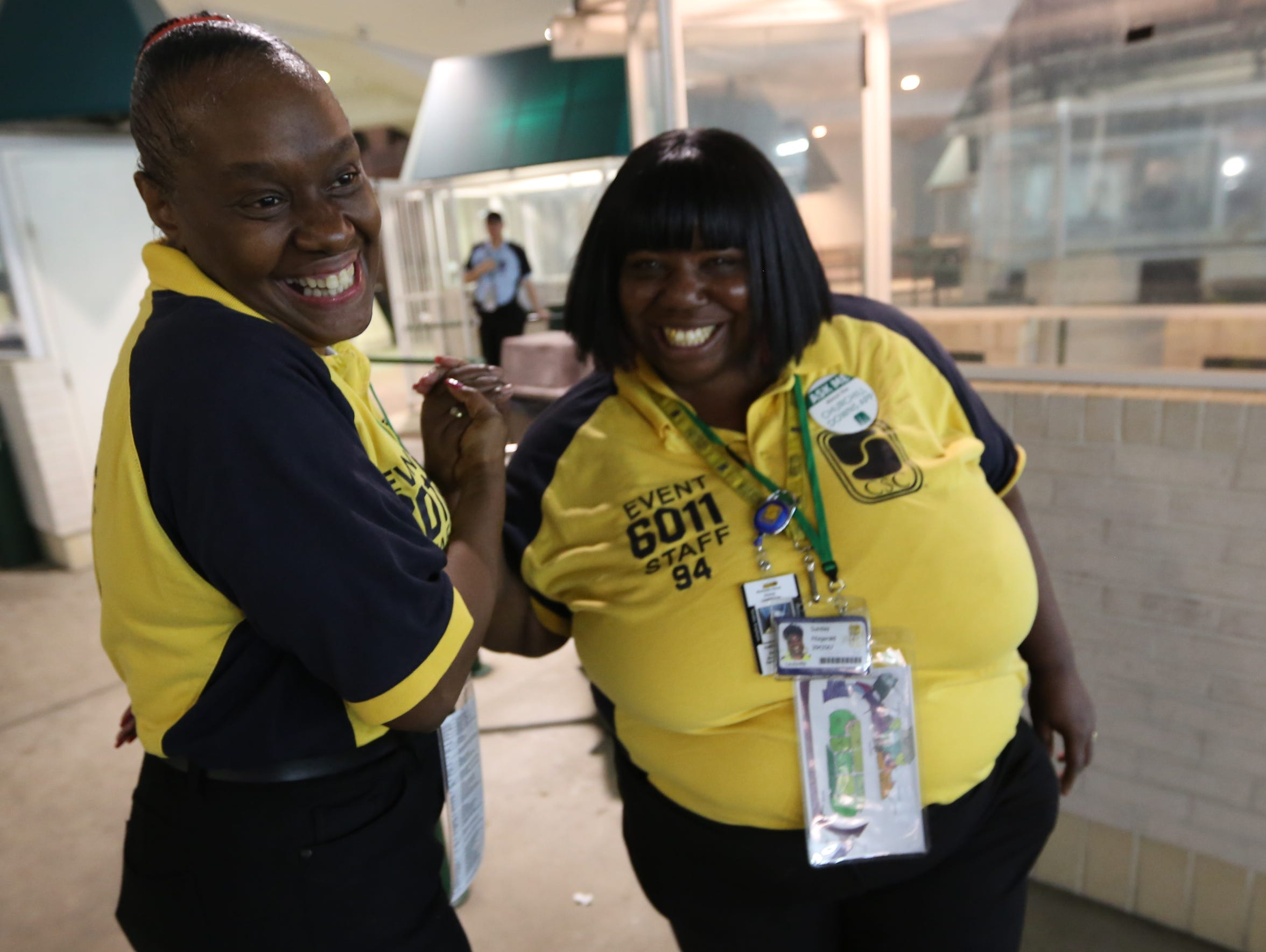 Security workers Sandra Frost, left, and Sunday Fitzgerald