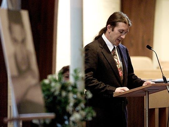 A photo of Kevyn Aucoin (foreground) sits at the front the church while Keith Aucoin speaks at a memorial service for his brother renowned makeup artist Kevyn Aucoin.  Aucoin died in New York City from complication involving brain surgery. Friends and family gathered on Wednesday afternoon at St. Mary's Church to remember and pay tribute to the Lafayette native.