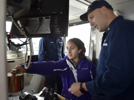 Under her father Boatswain's Mate Chief Petty Officer Adam Lempke's guidance, daughter Madison Lempke, both of Sevastopol, releases the whistle on the United States Coast Guard Cutter Mobile Bay. The whistle command was one long (meaning heading out) and three shorts (backing up). Homeported in Sturgeon Bay, the ice breaker hosted about a half dozen family members and guests for a buoy run in the Sturgeon Bay Canal on Thursday.