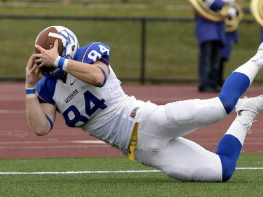 A Widener University player makes a diving catch during last season's MAC game at Lebanon Valley College.