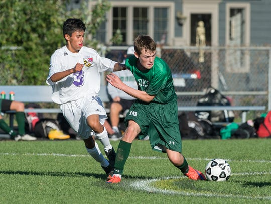 Crisfield's Enrique Cano (3) collides with Parkside's