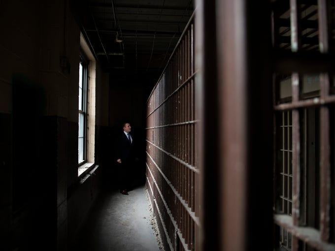 Freeholder Bill Moen explores an old jail housed on