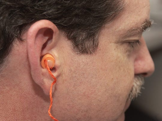 Stephen Guryan, executive director of the Speech Hearing and Learning Center, shows one of the simple hearing protection devices, an ear plug, that can protect from loud noise and subsequent hearing loss.