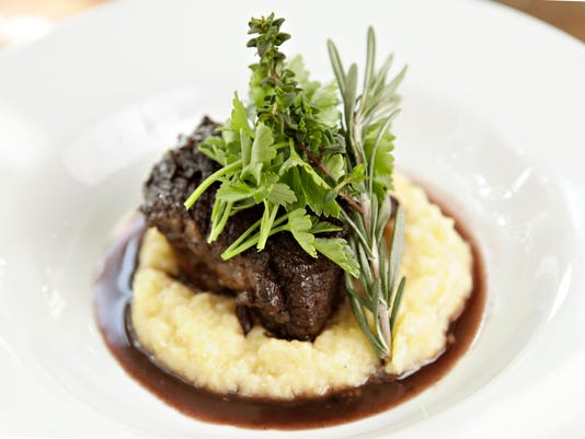 Polenta topped with braised beef short rib
