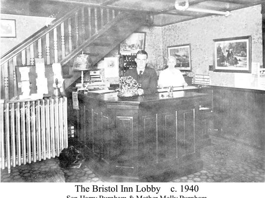 The Bristol Inn lobby circa 1940 with Harry Burnham and his mother, Molly, behind the front desk.