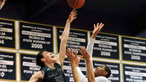 Christ School rising senior John Fulkerson, left, tied a single-season school record for blocks (93) last season.