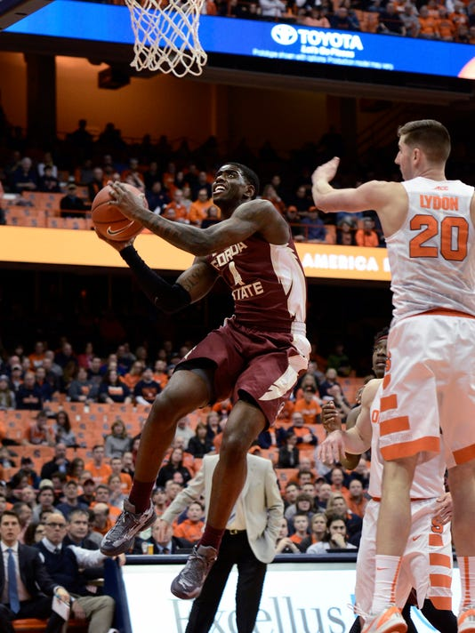 Florida State's Dwayne Bacon, left, goes to the basket against Syracuse's Tyler Lydon during the first half of an NCAA college basketball game in Syracuse, N.Y., Thursday, Feb. 11, 2016. (AP Photo/Heather Ainsworth)