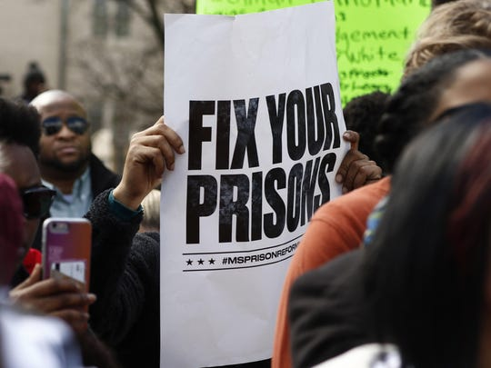 Protesters demonstrate against prison conditions at a rally in front of the Mississippi Capitol in Jackson on Friday.