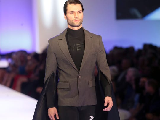Model wearing Viktor Luna's design walks the catwalk