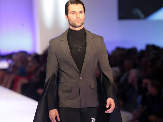 Model wearing Viktor Luna's design walks the catwalk at Fashion Week El Paseo on Tuesday, March 20, 2018 in Palm Desert.