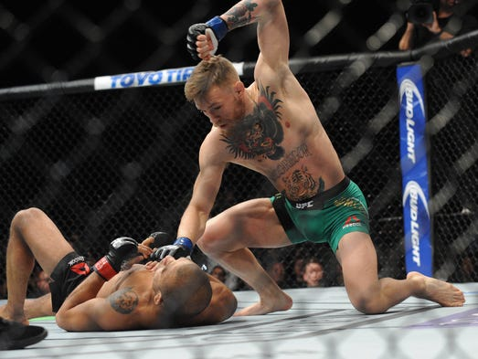 Conor McGregor lands punches to win a technical knockout