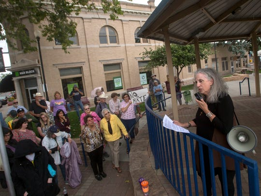 Rebecca Morgan speaks to participants in a vigil for the victims of Charlottesville, Virginia,Tuesday at Orchard Park.