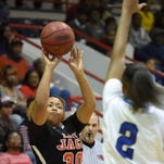 Holmes County's Namiya Wilson (30) shoots a trey over Murrah's Jamaica Almonds (2) in the championship game of the JPS Holiday Tournament on Tuesday, December 29, 2015, at Forest Hill High School in Jackson, Miss.