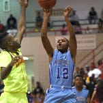 Murrah's Patrick Wigley (12) shoots over Callaway's Quay Kinnard (11) in the championship game of the JPS Holiday Tournament on Tuesday, December 29, 2015, at Forest Hill High School in Jackson, Miss.