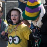 Cayden English, left, and Lynda English, right, has to celebrate Mardi Gras at Escambia Westgate School Friday morning Feb. 5 2016.