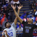 Canton's Jerman Rogers (4) shots over Murrah's Adam Wallace (14) on Friday, February 12, 2016, at Canton High School in Canton, Miss.
