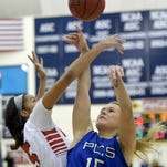 PCS' Reagan Dykes (15) is fouled by MRA's Amber Landing Saturday in the MAIS Overall Basketball Tournament finals at the A.E. Wood Coliseum on the Mississippi College campus in Clinton.