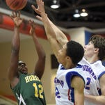Montgomery County's Demarius Womack shoots a fade-away jumper against two Ingomar Falcons on Tuesday in the MHSAA Class 1A state basketball tournament at the Lee E. Williams Athletics & Assembly Center at Jackson State.