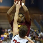 Laurel's Omar Bayless looks to shoot over Center Hill's Chad Joyner (25) on Wednesday in the MHSAA state basketball tournament at the Lee E. Williams Athletics & Assembly Center on the Jackson State University campus.