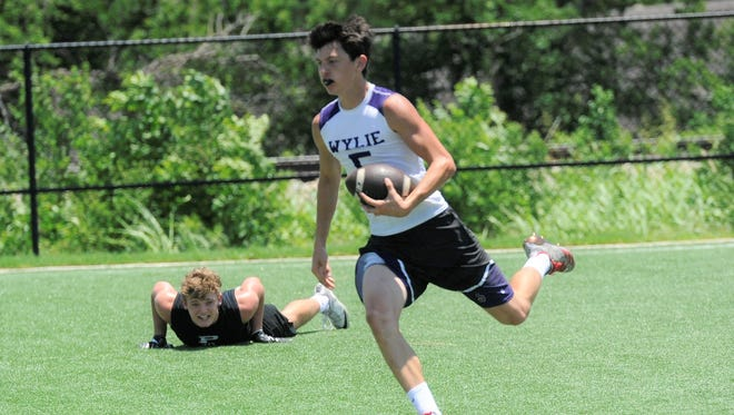 Wylie receiver Calvin Tiner (5) eases into the end zone as an Odessa Permian defender watches during the Bulldogs' second Pool C contest in the Abilene 7-on-7 State Qualifier Tournament on Friday at The Fieldhouse, formerly Action Zone. Permian won, 42-13.