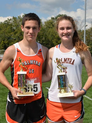 Palmyra High School's Matt Carroll and Sarah Hollen hold their trophies for first place wins at the Lebanon County Cross Country Championships, held at Annville-Cleona High School on Saturday.