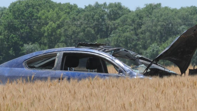 A vehicle that had two girls, a 16-year-old and 14-year-old, inside the vehicle rolled off the side of the 5300 block of West Crawford Street and into a wheat field on Friday afternoon.