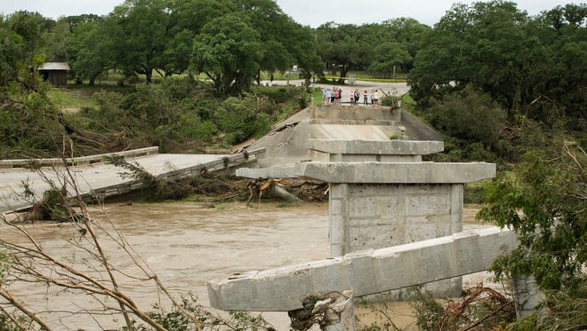 The Fischer Store Road bridge over the Blanco River near Wimberley, Texas, is destroyed after a flood on Sunday.