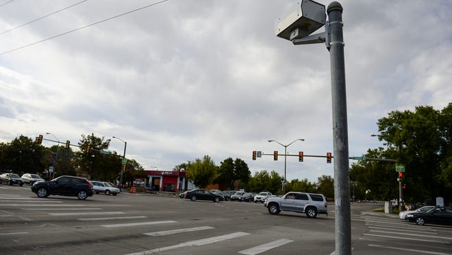 Cars pass by a red light camera on Drake and College on Sept. 10, 2015, in Fort Collins.