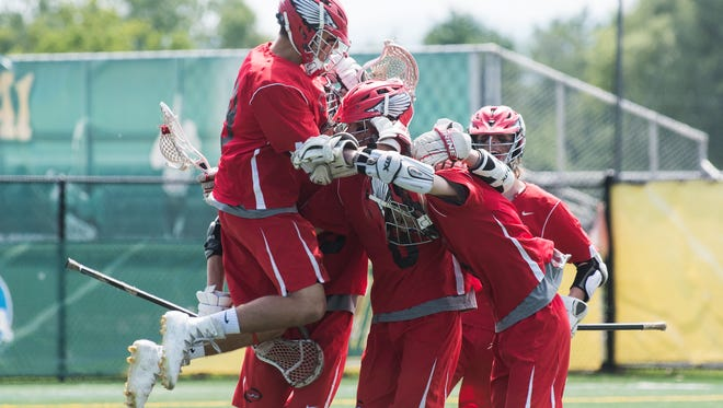 CVU celebrates a goal during the Division I boys lacrosse championship game between the Champlain Valley Union Redhawks and the South Burlington Rebels at UVM's Virtue Field on Saturday June 10, 2017 in Burlington.