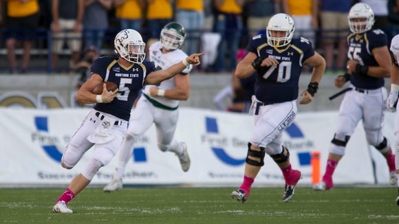 In this photo provided by Montana State University, Montana St quarterback Dakota Prukop (5) directs blockers while running the ball during the first half of an NCAA football game Saturday, October 10, 2015 in Bozeman, Mont. (AP photo/Kelly Gorham, Montana State University)