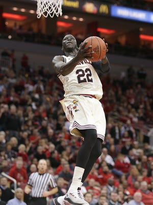 Louisville's Deng Adel goes up for a reverse layup during second half action against Syracuse. Feb. 5, 2018.