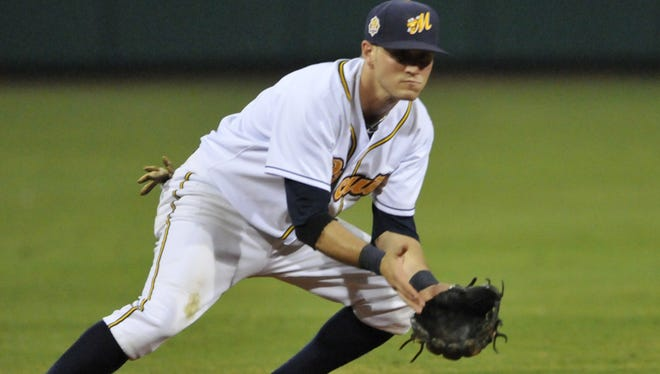 Montgomery shortstop Shawn O'Malley moves to field a Pensacola grounder.  LLOYD GALLMAN/ADVERTISER Montgomery Biscuits' Shawn O'Malley (11) prepares to stop a Pensacola Blue Wahoos hit during their game on Tuesday, June 4, 2013, at Riverwalk Stadium in Montgomery, Ala.. (Montgomery Advertiser, Lloyd Gallman)