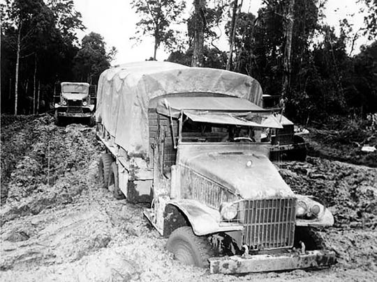 A Red Ball Express truck stuck in the mud during World War II.