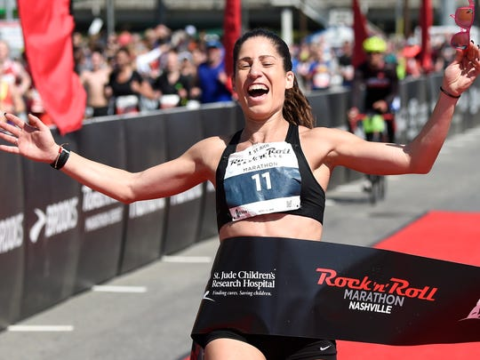 Stella Christoforou of Fort Campbell, Ky., wins the women's marathon.