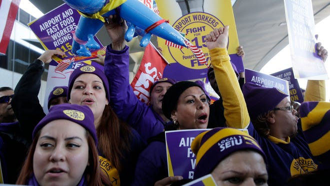 Protesters gather at Chicago's O'Hare International Airport on Nov. 29 as part of a nationwide protest for a $15 per hour minimum wage. The minimum wages for workers will rise in 19 states in 2017.