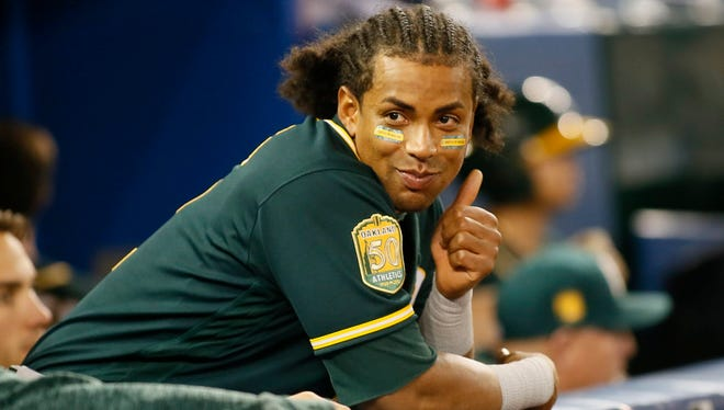 Khris Davis was all smiles on Thursday night after going 4 for 4 for the A's in a victory over the Blue Jays.