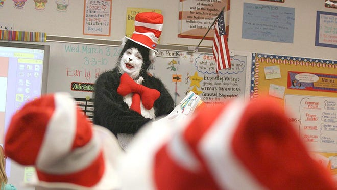 "Duke Wizner, Jr., dressed as ""The Cat in the Hat"" character, reads to second graders at Chaparral Elementary School in Higley, Ariz. on Wednesday, March 3, 2010."