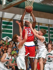 Spartanburg Day's Zion Williamson is fouled by Shannon