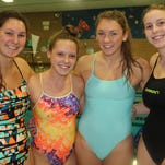 Behind the efforts of (left to right), Christina Schott, Lauren Biglin, Sophia Schott and Mary Kate Nodland, Birmingham Marian won the 200-free relay which helped lead to a runner-up finish at the Oakland County meet.