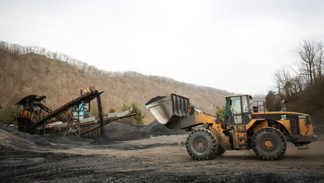A front loader moves a shovel full of coal at Clark Pergrem's Onyx Coal and Matt/Co Inc. coal processing facility in Prestonsburg, Ky. March 24, 2015