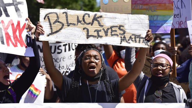 Ange Musoni, an organizer, leads hundreds of people during a protest against police brutality in downtown Ridgefield Park, N.J. on Monday June 8, 2020.