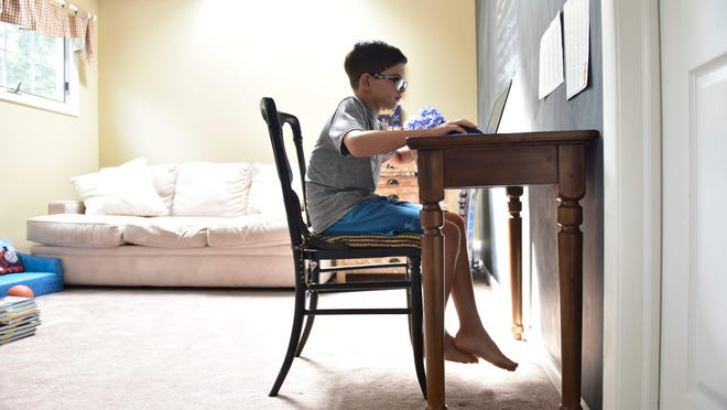 Henry Seltzer, 7, studies at his desk in Waldwick, N.J. on Friday Aug. 7, 2020. When the school year begins Henry and some other schoolmates will be continuing distant learning in home pods.