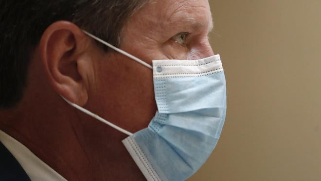 Georgia Gov. Brian Kemp looks on during a coronavirus briefing at the Capitol Friday, July 17, 2020, in Atlanta.  Kemp sued the city of Atlanta over its face-mask requirement just after President Donald Trump arrived in the city without wearing a mask, Mayor Keisha Lance Bottoms said Friday.