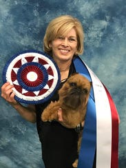 Newton, a Brussels Griffon, and his handler, Susan
