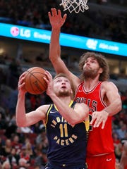 Chicago Bulls center Robin Lopez (42) tries to block
