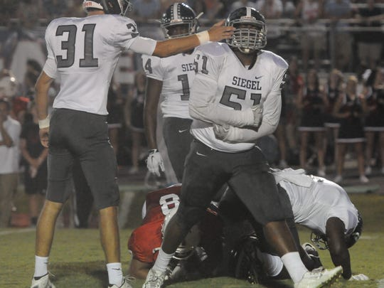 Siegel's Antwon Griffith (51) celebrates after making a tackle-for-loss Friday.