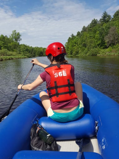 Courtney Lamm paddles down the Wolf River in Menominee