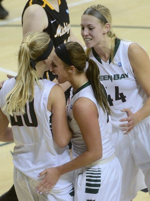 Green Bay Phoenix' Jessica Lindstrom is congratulated on a play by teammates Mehryn Kraker and Mariah Monke in a Nov. 1 game against Michigan Tech.