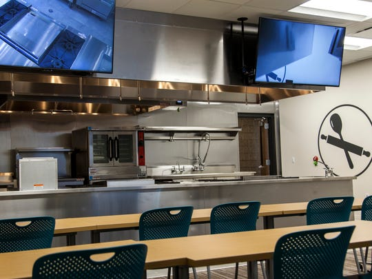 A kitchen sits inside the demonstration classroom that
