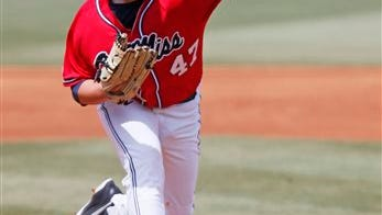 Ole Miss pitcher Christian Trent throws to a Washlngton batter in the first inning of an NCAA college baseball regional tournament game in Oxford, Miss., Sunday, June 1, 2014. (AP Photo/Rogelio V. Solis)